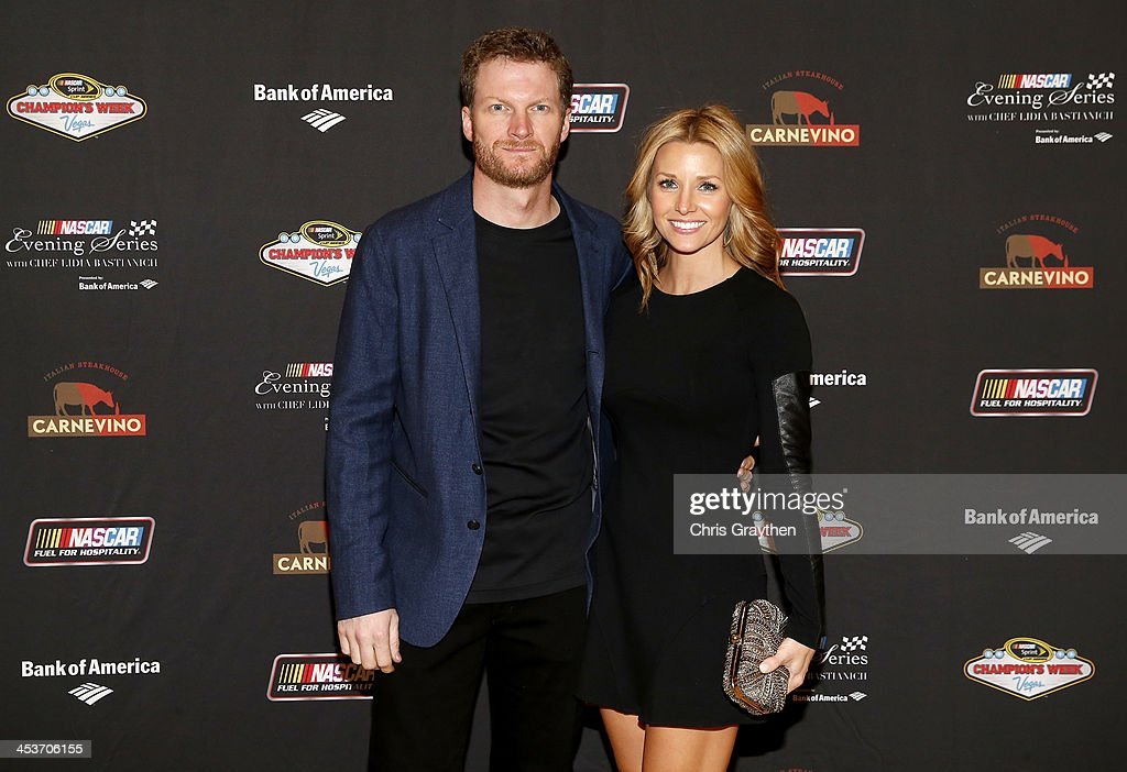 Sprint Cup driver <a gi-track='captionPersonalityLinkClicked' href=/galleries/search?phrase=Dale+Earnhardt+Jr.&family=editorial&specificpeople=171293 ng-click='$event.stopPropagation()'>Dale Earnhardt Jr.</a> and girlfriend <a gi-track='captionPersonalityLinkClicked' href=/galleries/search?phrase=Amy+Reimann&family=editorial&specificpeople=8696311 ng-click='$event.stopPropagation()'>Amy Reimann</a> pose for a picture at the NASCAR Evening Series Presented by Bank of America at Carnevino at The Palazzo Las Vegas on December 4, 2013 in Las Vegas, Nevada.