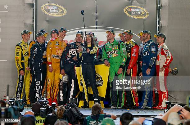 Sprint Cup Drivers take a selfie with Miss Sprint Cup Juliana White after making the Chase for the Sprint Cup during the Post Race Party after the...
