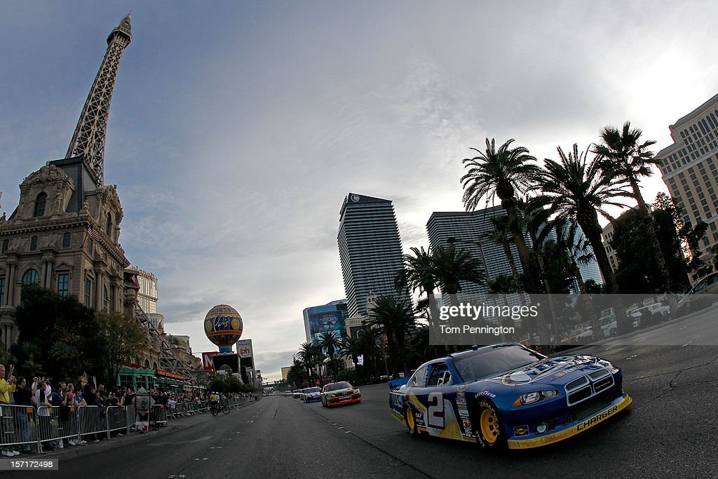 Sprint Cup Series Champion Brad Keselowski, driver of the #2 Miller Lite Dodge, drives down Las Vegas during the NASCAR Victory Lap on the Las Vegas Strip on November 29, 2012 in Las Vegas, Nevada.