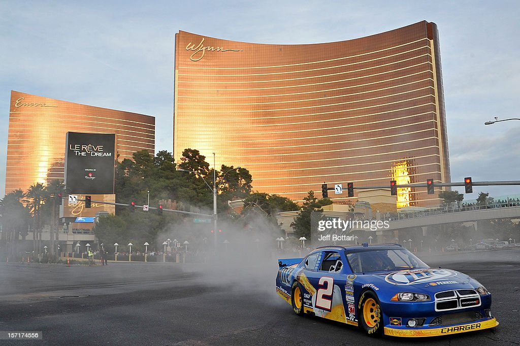 Sprint Cup Series Champion Brad Keselowski, driver of the #2 Miller Lite Dodge, does a burnout during the NASCAR Victory Lap on the Las Vegas Strip at Wynn Las Vegas on November 29, 2012 in Las Vegas, Nevada.