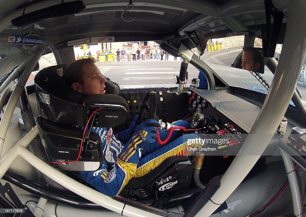 Sprint Cup Series Champion <a gi-track='captionPersonalityLinkClicked' href=/galleries/search?phrase=Brad+Keselowski&family=editorial&specificpeople=890258 ng-click='$event.stopPropagation()'>Brad Keselowski</a>, driver of the #2 Miller Lite Dodge, drives on the street during the NASCAR Victory Lap on the Las Vegas Strip on November 29, 2012 in Las Vegas, Nevada.