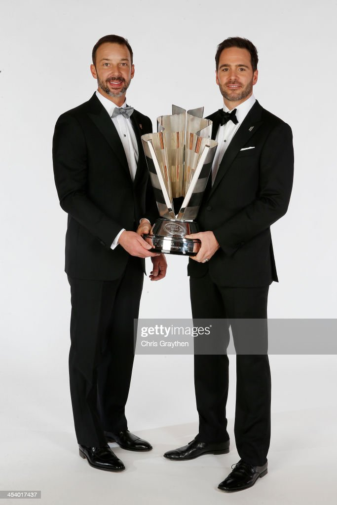 Sprint Cup Series Champion Jimmie Johnson (R) and his crew chief <a gi-track='captionPersonalityLinkClicked' href=/galleries/search?phrase=Chad+Knaus&family=editorial&specificpeople=564401 ng-click='$event.stopPropagation()'>Chad Knaus</a> pose for a portrait prior to the NASCAR Sprint Cup Series Champion's Awards at Wynn Las Vegas on December 6, 2013 in Las Vegas, Nevada.