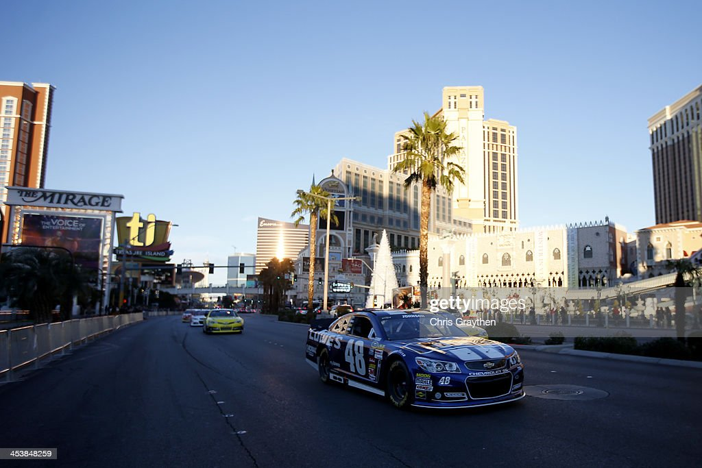 Sprint Cup Series Champion Jimmie Johnson drives during NASCAR Victory Lap on the Las Vegas Strip on December 5 2013 in Las Vegas Nevada