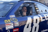 Sprint Cup Series Champion Jimmie Johnson gives a thumbs up as he drives during NASCAR Victory Lap on the Las Vegas Strip on December 5 2013 in Las...