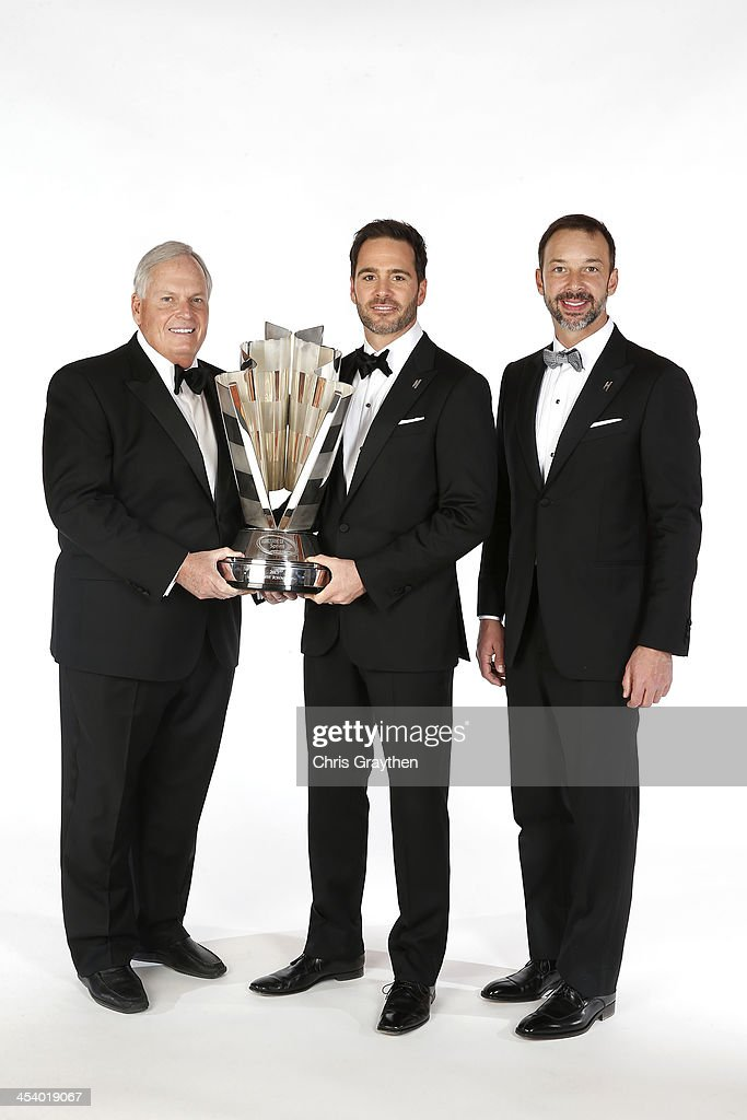 Sprint Cup Series Champion Jimmie Johnson (C), team owner <a gi-track='captionPersonalityLinkClicked' href=/galleries/search?phrase=Rick+Hendrick&family=editorial&specificpeople=596436 ng-click='$event.stopPropagation()'>Rick Hendrick</a> (L) and crew chief <a gi-track='captionPersonalityLinkClicked' href=/galleries/search?phrase=Chad+Knaus&family=editorial&specificpeople=564401 ng-click='$event.stopPropagation()'>Chad Knaus</a> pose for a portrait prior to the NASCAR Sprint Cup Series Champion's Awards at Wynn Las Vegas on December 6, 2013 in Las Vegas, Nevada.