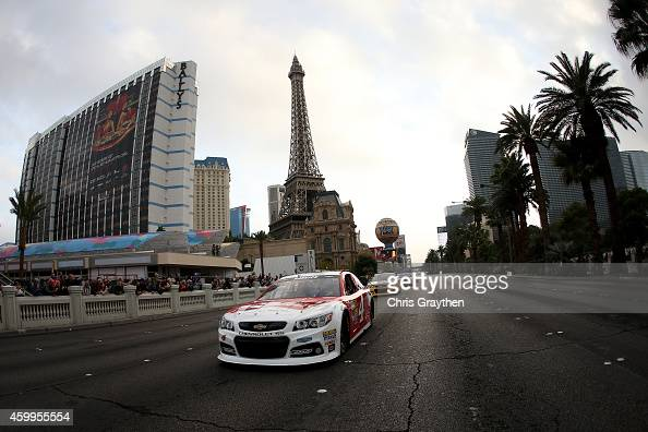 Sprint Cup Series Champion Kevin Harvick drives during the NASCAR Victory Lap on the Las Vegas Strip on December 4 2014 in Las Vegas Nevada