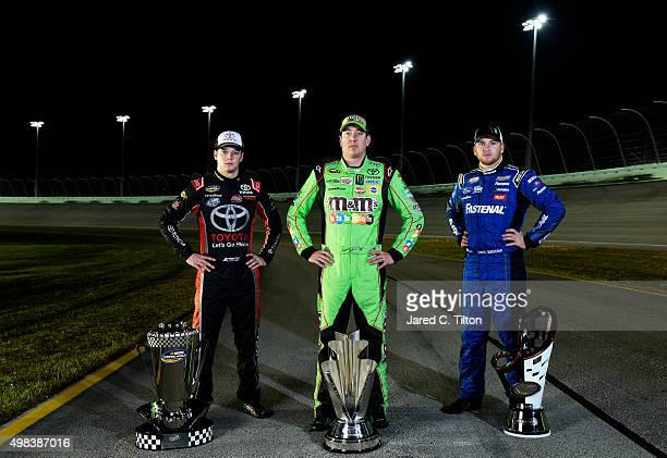 Sprint Cup Series champion Kyle Busch driver of the MM's Crispy Toyota NASCAR XFINITY Series champion Chris Buescher driver of the Fastenal Ford and...