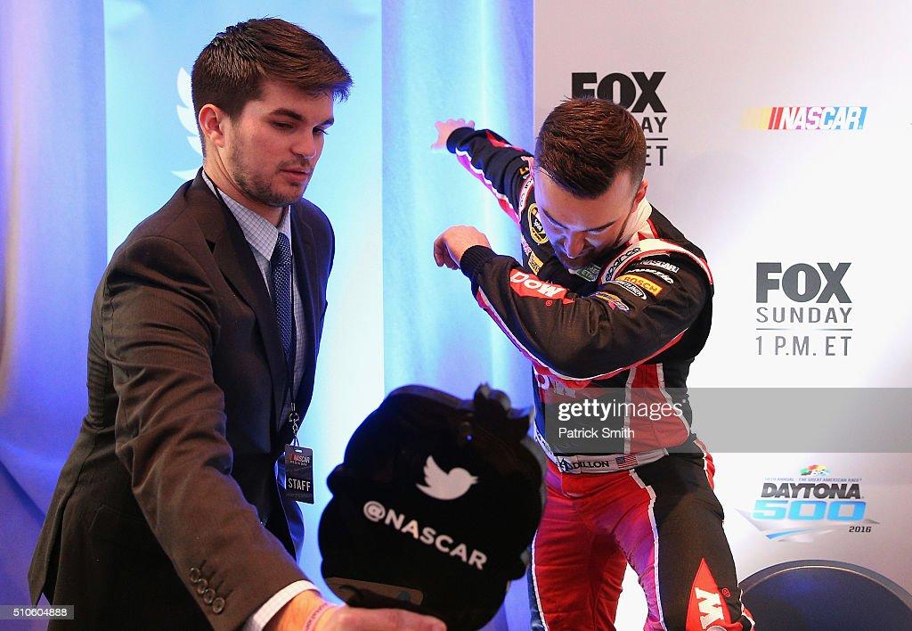 Sprint Cup Series driver Austin Dillon gestures during NASCAR Media Day at Daytona International Speedway on February 16 2016 in Daytona Beach Florida