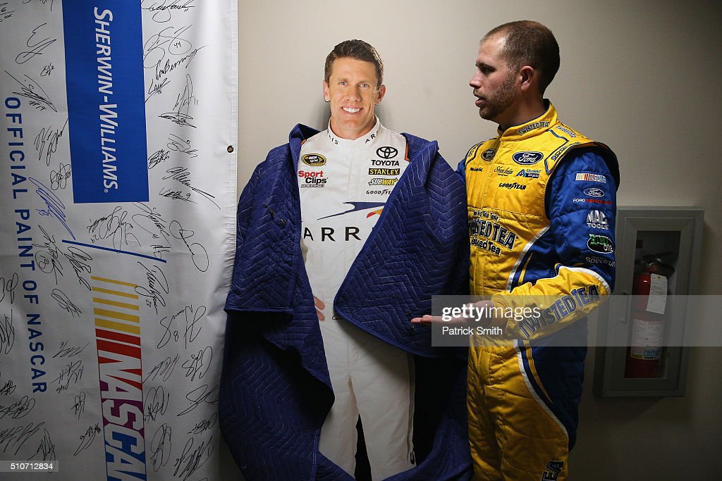 Sprint Cup Series driver Brian Scott poses with a cardboard cutout of NASCAR Sprint Cup Series driver Carl Edwards during NASCAR Media Day at Daytona...