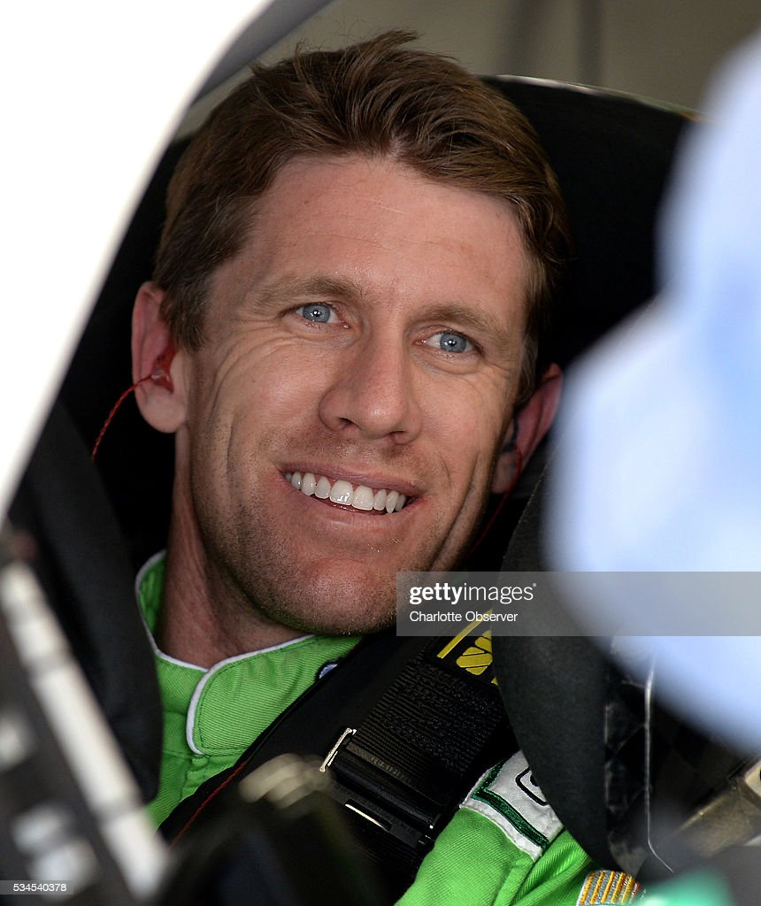 Sprint Cup Series driver Carl Edwards talks with passerby prior to practice at Charlotte Motor Speedway in Concord, N.C., on Thursday, May 26, 2016.