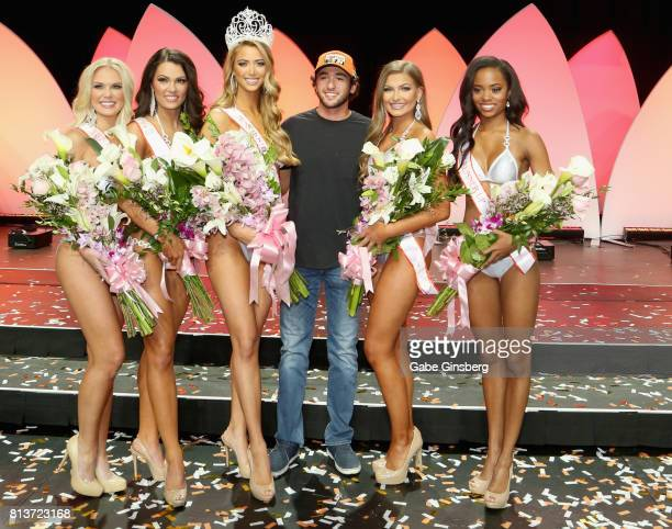 Sprint Cup series driver Chase Elliott poses with the top five finalists third runnerup Rachel Swartz of Chantilly Virginia first runnerup Amberly...