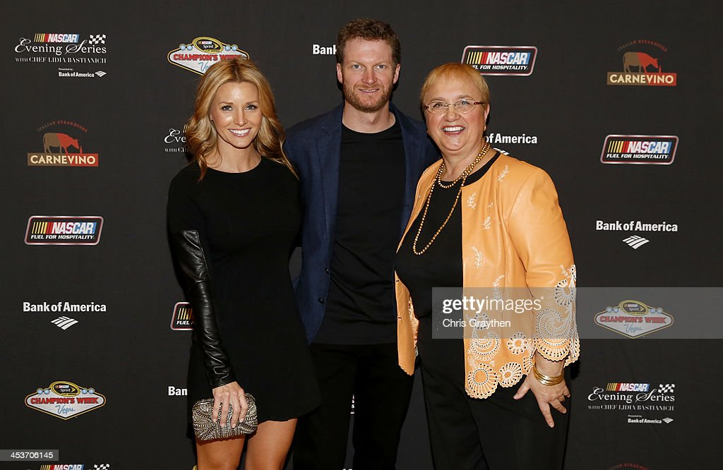 Sprint Cup Series driver <a gi-track='captionPersonalityLinkClicked' href=/galleries/search?phrase=Dale+Earnhardt+Jr.&family=editorial&specificpeople=171293 ng-click='$event.stopPropagation()'>Dale Earnhardt Jr.</a> and girlfriend Amy Reimann pose for a picture with chef <a gi-track='captionPersonalityLinkClicked' href=/galleries/search?phrase=Lidia+Bastianich&family=editorial&specificpeople=4784020 ng-click='$event.stopPropagation()'>Lidia Bastianich</a> at the NASCAR Evening Series Presented by Bank of America at Carnevino at The Palazzo Las Vegas on December 4, 2013 in Las Vegas, Nevada.