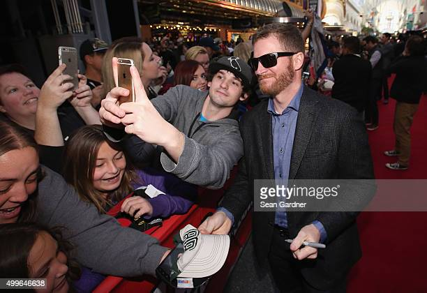 Sprint Cup Series driver Dale Earnhardt Jr interacts with fans during the NASCAR Sprint Cup Series FanFest hosted by Las Vegas Motor Speedway on the...