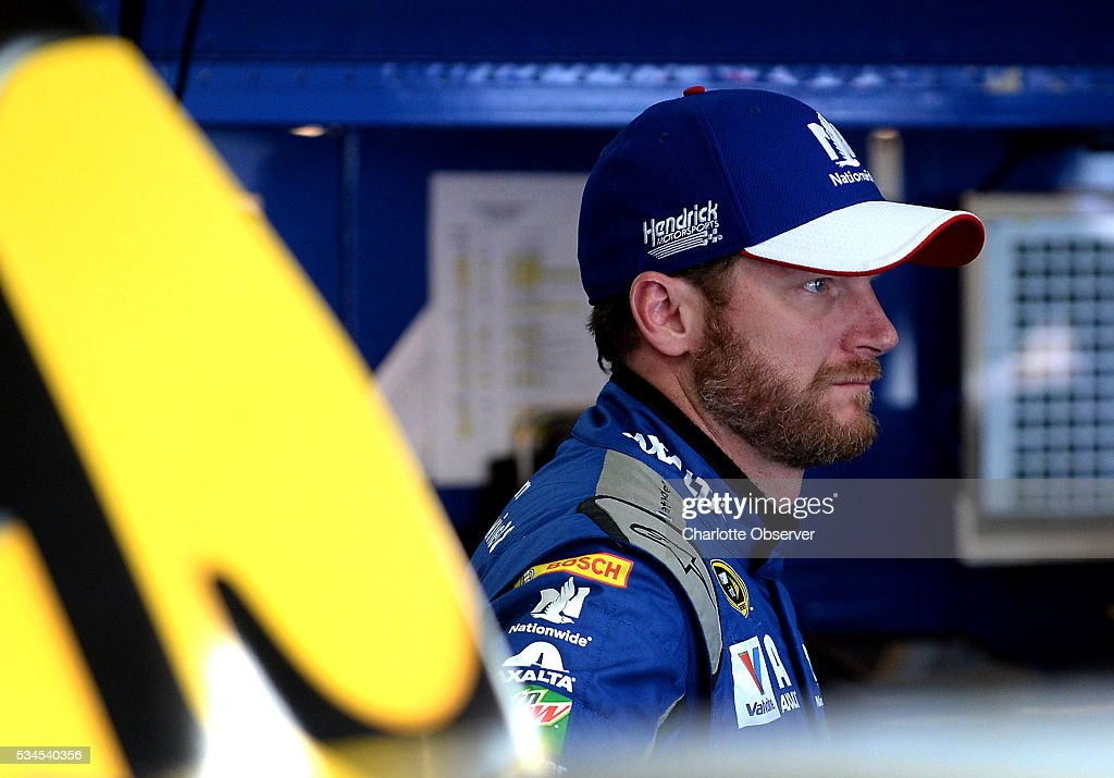Sprint Cup Series driver Dale Earnhardt Jr. waits in the garage as members of his team make adjustments to the car during practice at Charlotte Motor Speedway in Concord, N.C., on Thursday, May 26, 2016.