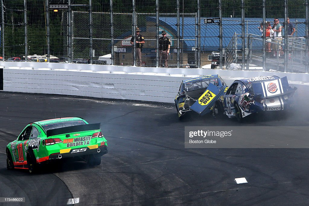 Sprint Cup Series driver Danica Patrick (#10) drives past a wreck between Sprint Cup Series driver Travis Kvapil (#93) and Sprint Cup Series driver Ricky Stenhouse Jr. (#17). New Hampshire Motor Speedway Camping World RV Sales 301.