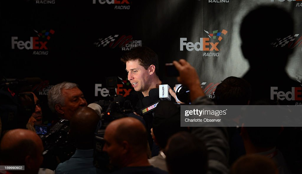 Sprint Cup Series driver Denny Hamlin is interviewed by the media during a break out session in the Sprint NASCAR Media Tour on Thursday, January 24, 2013, at the NASCAR Hall of Fame in Charlotte, North Carolina.