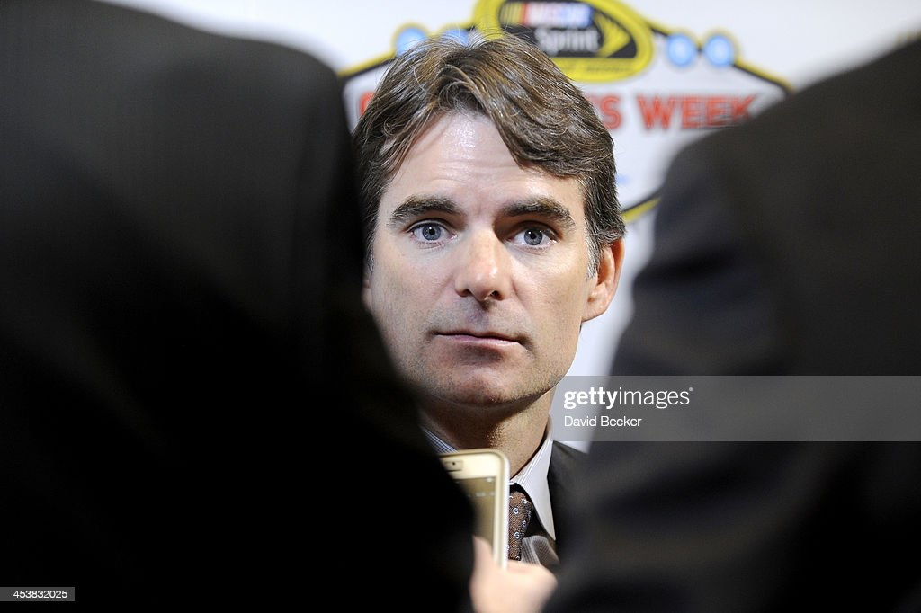 Sprint Cup Series driver <a gi-track='captionPersonalityLinkClicked' href=/galleries/search?phrase=Jeff+Gordon&family=editorial&specificpeople=171491 ng-click='$event.stopPropagation()'>Jeff Gordon</a> answers questions from the media after the NMPA Myers Brothers Awards Luncheon at the Encore Las Vegas on December 5, 2013 in Las Vegas, Nevada.