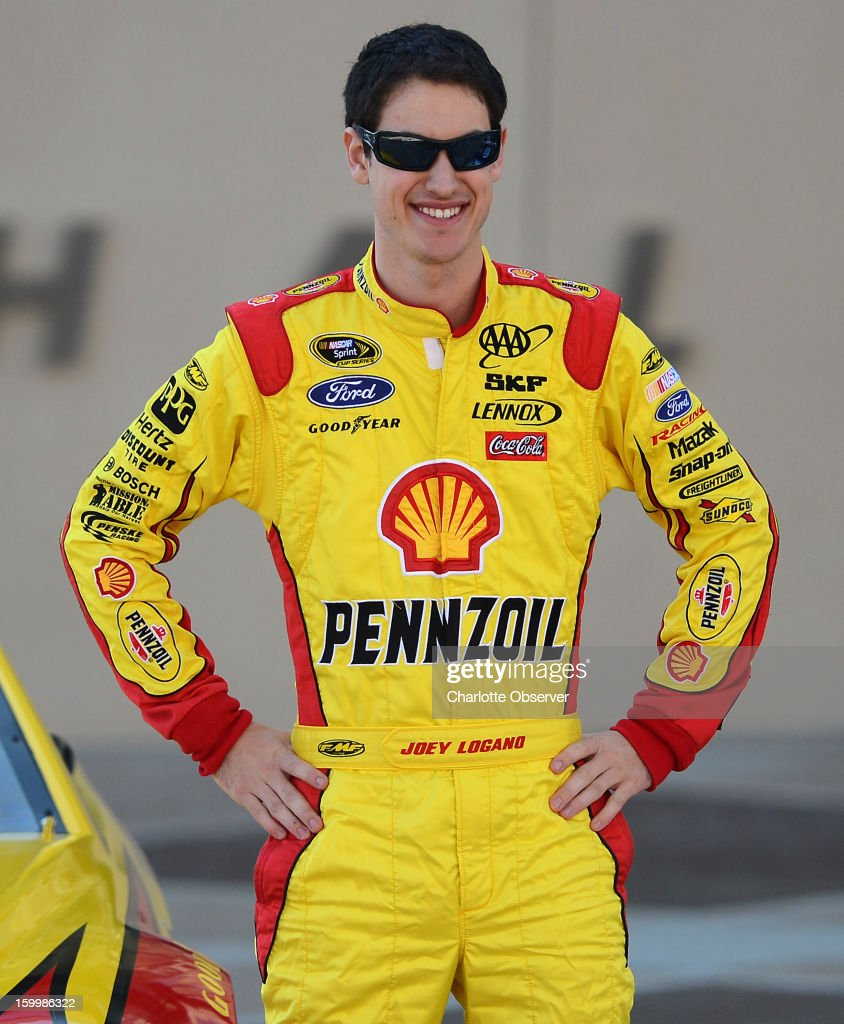 Sprint Cup Series driver Joey Logano poses next to his car in the NASCAR Hall of Fame Plaza following the Ford Racing parade through uptown Charlotte, North Carolina, Thursday, January 24, 2013. The parade featured all of the Ford drivers in the Sprint Cup Series for the 2013 season.