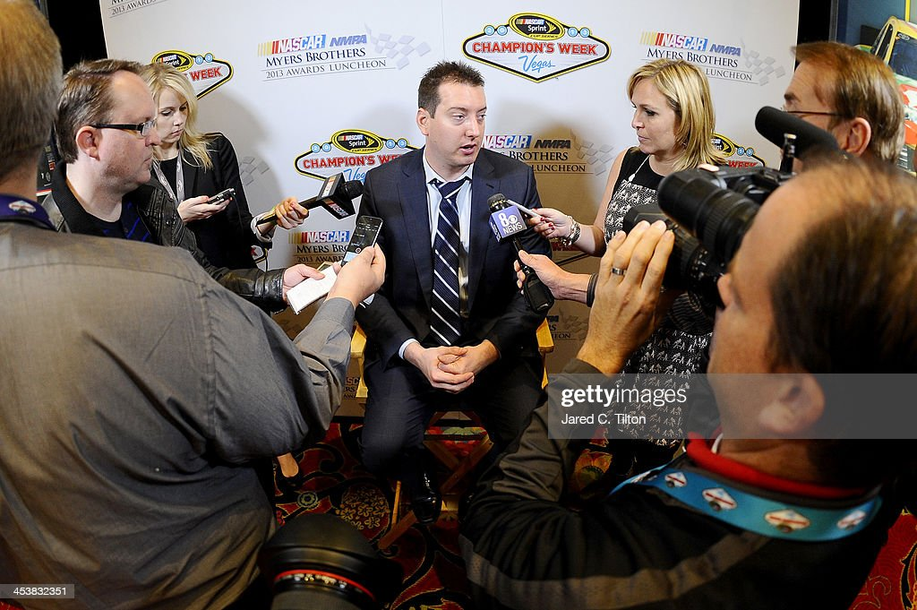 Sprint Cup Series driver <a gi-track='captionPersonalityLinkClicked' href=/galleries/search?phrase=Kyle+Busch&family=editorial&specificpeople=211123 ng-click='$event.stopPropagation()'>Kyle Busch</a> answers questions from the media after the NMPA Myers Brothers Awards Luncheon at the Encore Las Vegas on December 5, 2013 in Las Vegas, Nevada.