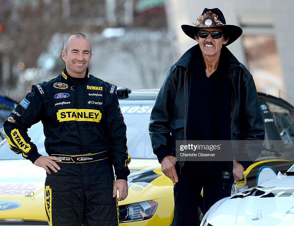 Sprint Cup Series driver Marcos Ambrose and owner Richard Petty pose next to his car in the NASCAR Hall of Fame Plaza following the Ford Racing parade through uptown Charlotte, North Carolina, Thursday, January 24, 2013. The parade featured all of the Ford drivers in the Sprint Cup Series for the 2013 season.