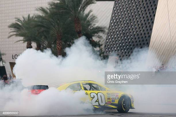 Sprint Cup Series driver Matt Kenseth does a burnout in his car during the NASCAR Victory Lap on the Las Vegas Strip on December 4 2014 in Las Vegas...