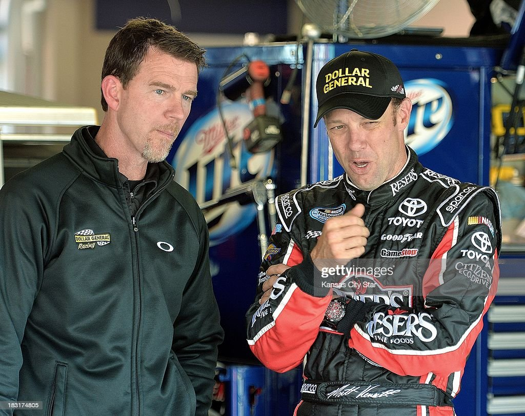 Sprint Cup Series driver Matt Kenseth, right, talks with crew chief Jason Ratcliff in the garage area on Saturday, October 5, 2013, at the Kansas Speedway in Kansas City, Kansas.