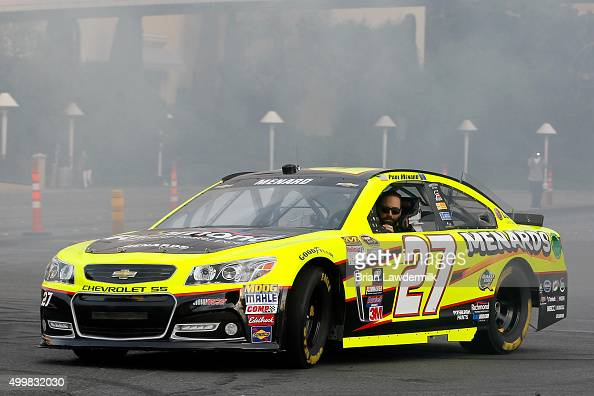 Sprint Cup Series driver Paul Menard performs a burnout during the NASCAR Victory Lap on the Las Vegas Strip on December 3 2015 in Las Vegas Nevada