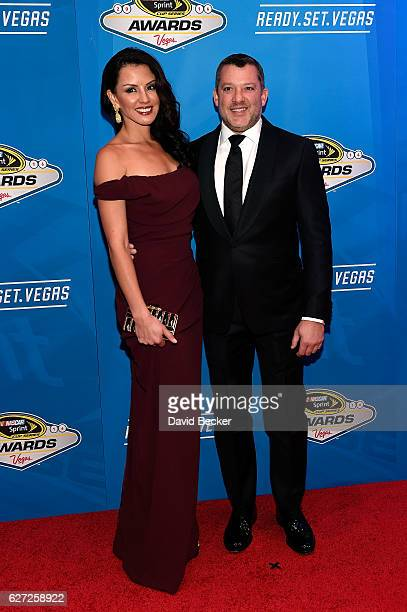 Sprint Cup Series driver Tony Stewart and his girlfriend Pennelope Jimenez attend the 2016 NASCAR Sprint Cup Series Awards at Wynn Las Vegas on...