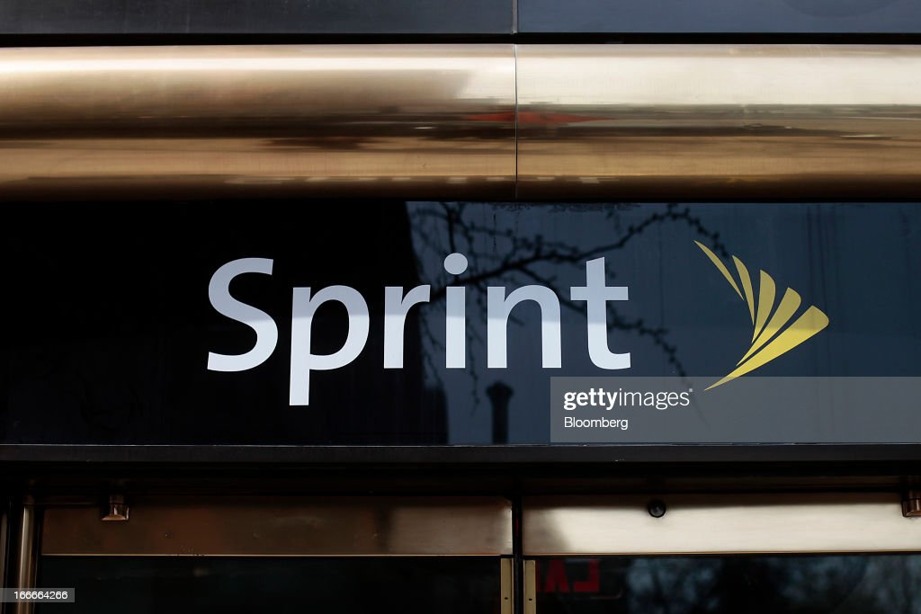 Sprint Nextel Corp. signage is displayed at store in New York, U.S., on Monday, April 15, 2013. Dish Network Corp., the satellite-TV company controlled by Charlie Ergen, made an unsolicited $25.5 billion offer for Sprint Nextel Corp., topping a Softbank Corp. bid for the third-largest U.S. wireless carrier. Photographer: Victor J. Blue/Bloomberg via Getty Images