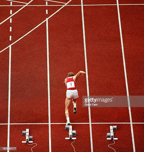 Sprint runner practising starts on a racing track