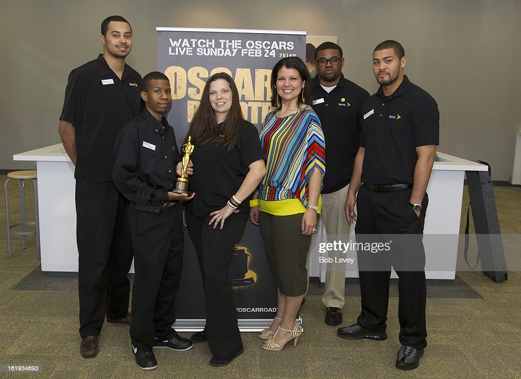 Sprint Store manager Cindi Simms (C) and Sprint store employees pose with the Oscar statue during the First-Ever Oscar Roadtrip on February 17, 2013 in Houston, Texas.