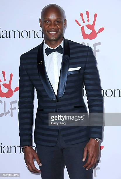 Sprinter Asafa Powell attends the Rihanna And The Clara Lionel Foundation 2nd Annual Diamond Ball at The Barker Hanger on December 10 2015 in Santa...