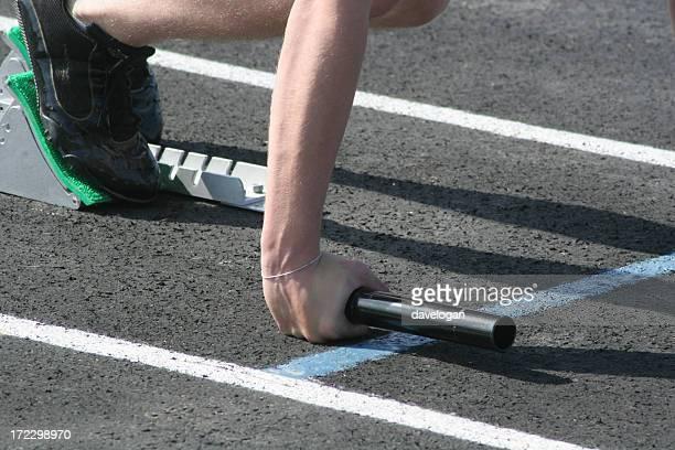 Sprinter At Start of Relay Race