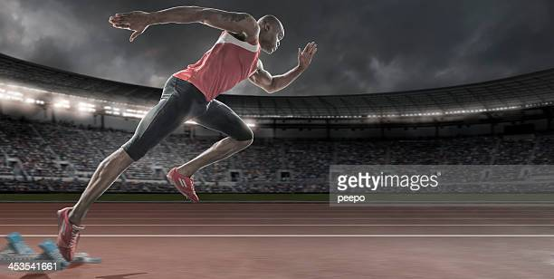 Sprinter in Mid Flow Bursting Out Of Starting Blocks