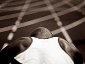 sprinter in starting blocks