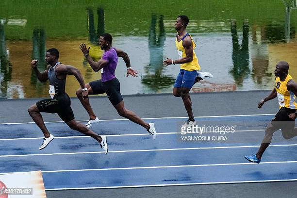 US sprinter Justin Gatlin runs along a 100 meter race track mounted over a pond during the Mano a Mano exhibition race event at Quinta da Boa Vista...