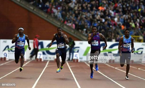 US sprinter Michael Rodgers Jamaican sprinters Yohan Blake Julian Forte and US sprinter Isiah Young compete in the men's 100 metres event during the...