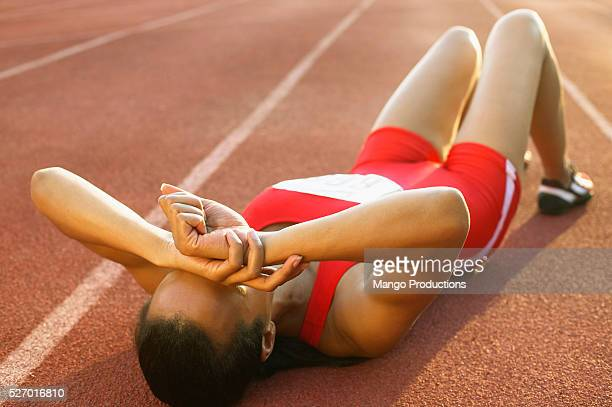 Sprinter Resting on Ground After Race