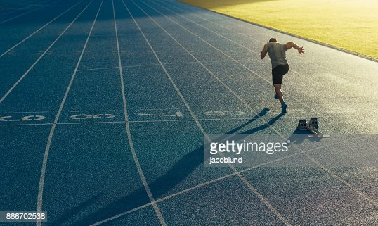 Sprinter running on track : Stock Photo