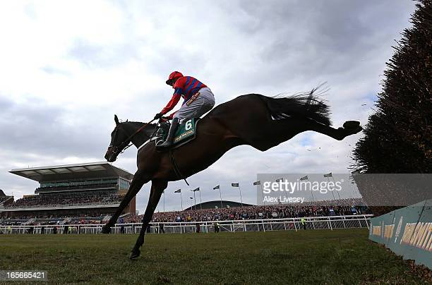 Sprinter Sacre ridden by Barry Geraghty clears the last fence to win the The John Smith's Melling Steeple Chase at Aintree Racecourse on April 5 2013...