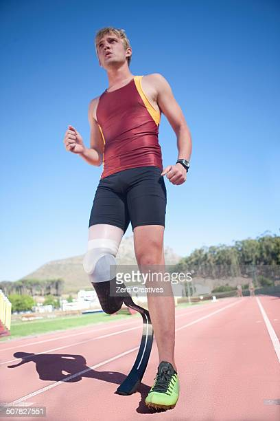 Sprinter standing with prosthetic leg on