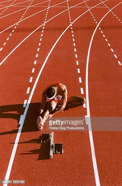 Sprinter Stretching on Track