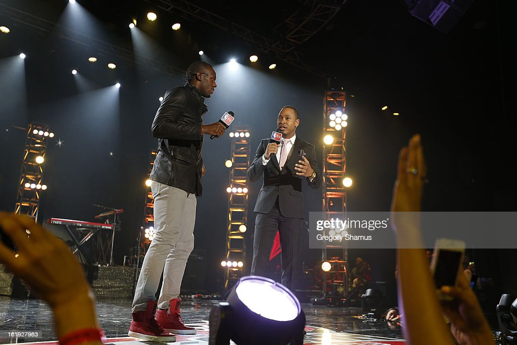 Sprinter Usain Bolt talks with Television Personality Terrence Jenkins during the Sprint NBA All-Star Pregame Concert in Sprint Arena during the NBA All-Star Weekend on February 17, 2013 at the George R. Brown Convention Center in Houston, Texas.