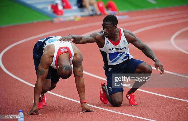 Sprinters Dwain Chambers gives colleague Mark LewisFrancis some advice during the Team GB Track and Field preperation camp at Monte Gordo Stadium on...