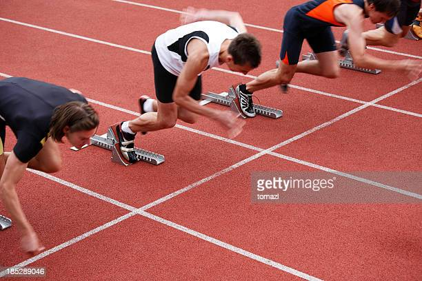 Sprinters in starting blocks