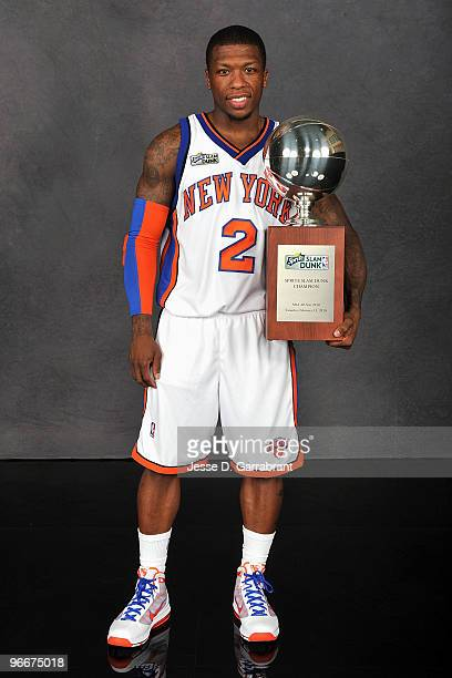 Sprite Slam Dunk Contest winner Nate Robinson of the New York Knicks poses with the trophy on AllStar Saturday Night as part of 2010 NBA AllStar...