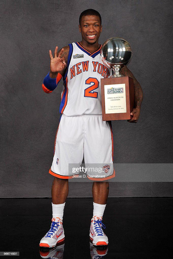 Sprite Slam Dunk Contest winner <a gi-track='captionPersonalityLinkClicked' href=/galleries/search?phrase=Nate+Robinson&family=editorial&specificpeople=208906 ng-click='$event.stopPropagation()'>Nate Robinson</a> poses with the trophy on All-Star Saturday Night, as part of 2010 NBA All-Star Weekend at American Airlines Center on February 13, 2010 in Dallas, Texas.