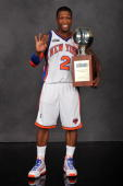 Sprite Slam Dunk Contest winner Nate Robinson poses with the trophy on AllStar Saturday Night as part of 2010 NBA AllStar Weekend at American...