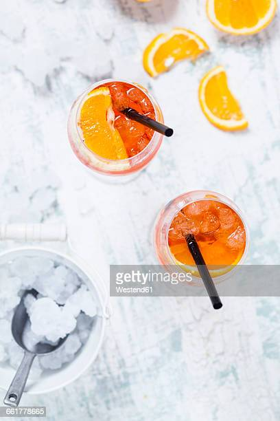 Aperol spritz, bitter liqueur, prosecco wine, sparkling mineral water and orange slice