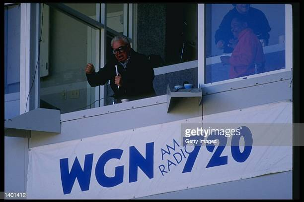 Sprotscaster Harry Carey sits in the broadcast booth at Wrigley Field in Chicago Illinois Mandatory Credit Allsport /Allsport